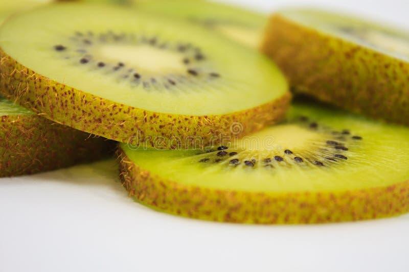 Beautiful kiwi fruit slices on white. Background royalty free stock images