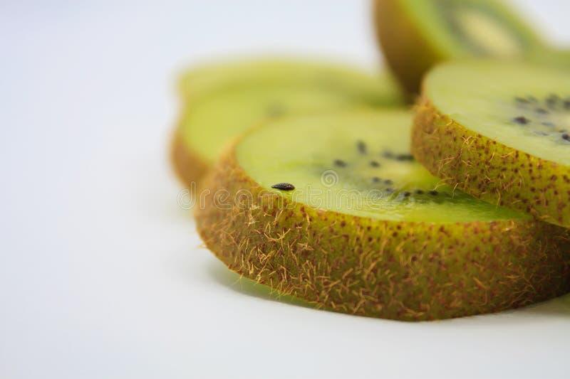 Beautiful kiwi fruit slices on white. Background royalty free stock photo