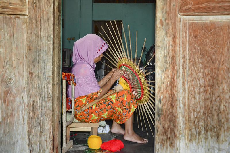 Klaten Indonesia. 15 June 2015. Activities of traditional umbrella makers from Juwiring Klaten Indonesia. The beautiful Klaten umbrella craft is known as the royalty free stock photo