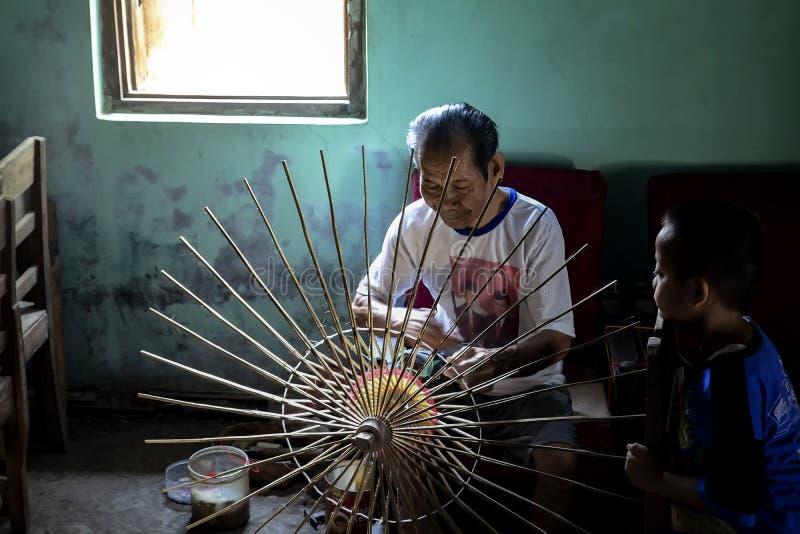 Klaten Indonesia. 15 June 2015. Activities of traditional umbrella makers from Juwiring Klaten Indonesia. The beautiful Klaten umbrella craft is known as the stock images