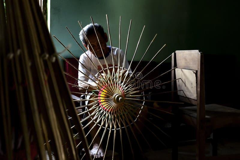 Klaten Indonesia. 15 June 2015. Activities of traditional umbrella makers from Juwiring Klaten Indonesia. The beautiful Klaten umbrella craft is known as the stock photos