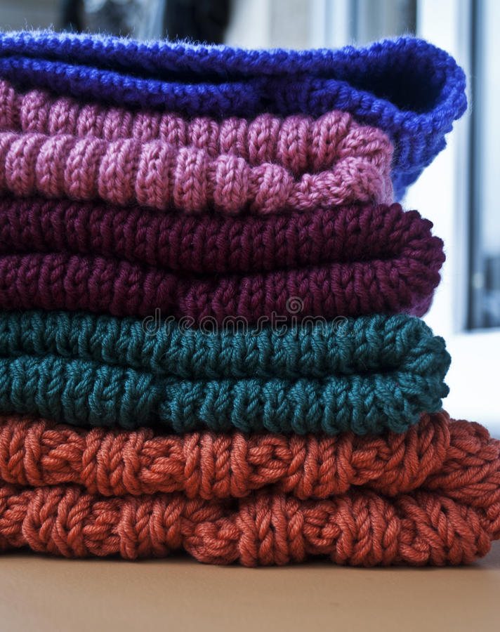 Beautiful knitted hats royalty free stock photography