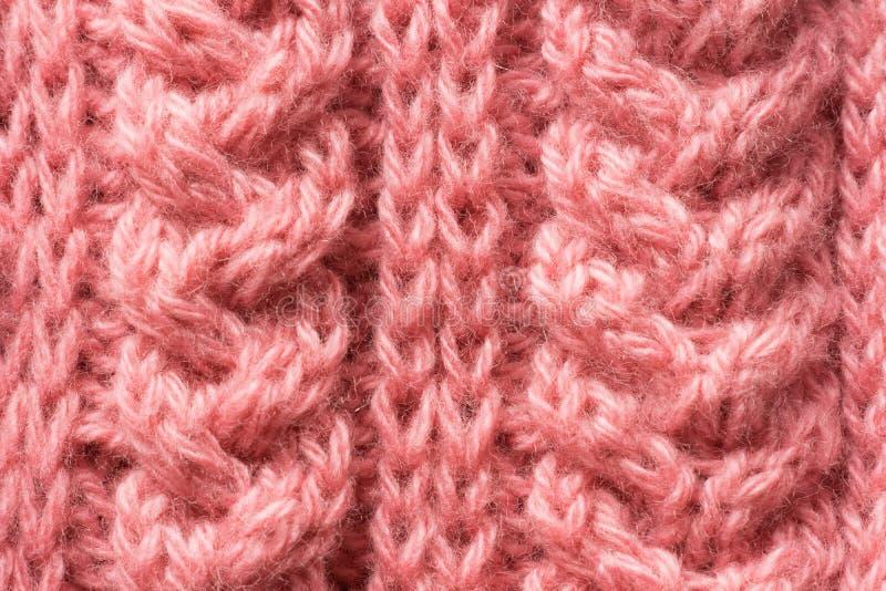 Beautiful knitted pattern. Pink yarn stock photography