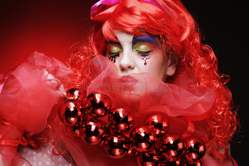 Beautiful lady with artistic make-up holding Christmas decoratio stock photography