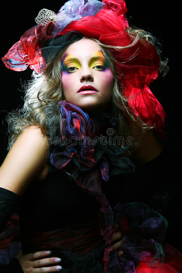 Beautiful lady with artistic make-up. royalty free stock photography