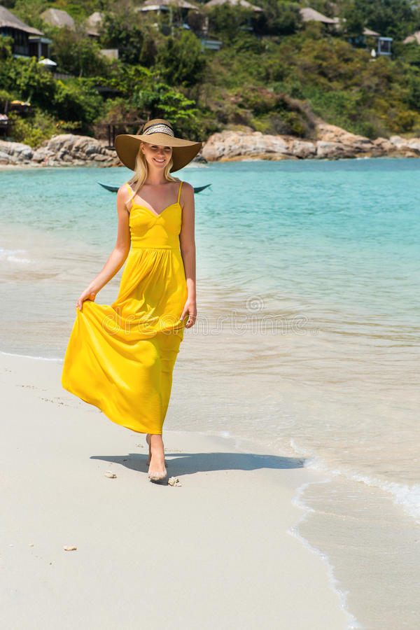 Beautiful lady on the beach stock images