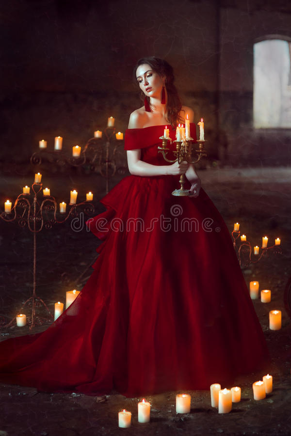 Beautiful lady with candles royalty free stock image