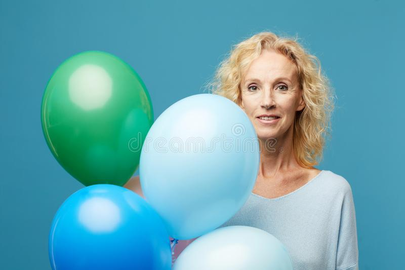 Beautiful lady with colorful helium balloons royalty free stock photo