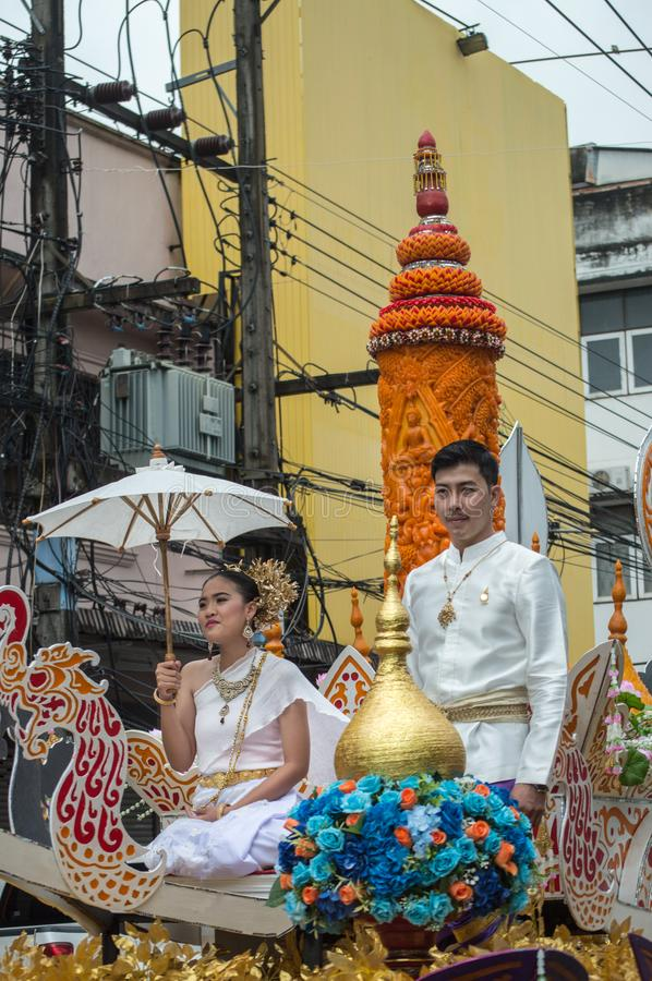 Beautiful lady on the float and The ornately carved beeswax candles paraded around Chiang Rai town. Chiang Rai, Thailand - July 26, 2018 : Candle Festival royalty free stock images