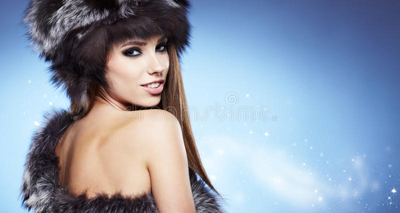 Download Beautiful lady in fur cap stock photo. Image of clothes - 28129076