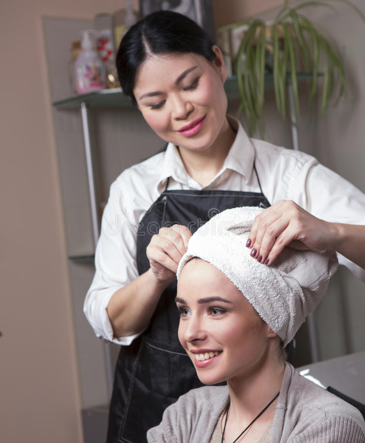 Beautiful lady in hairdressing saloon royalty free stock images