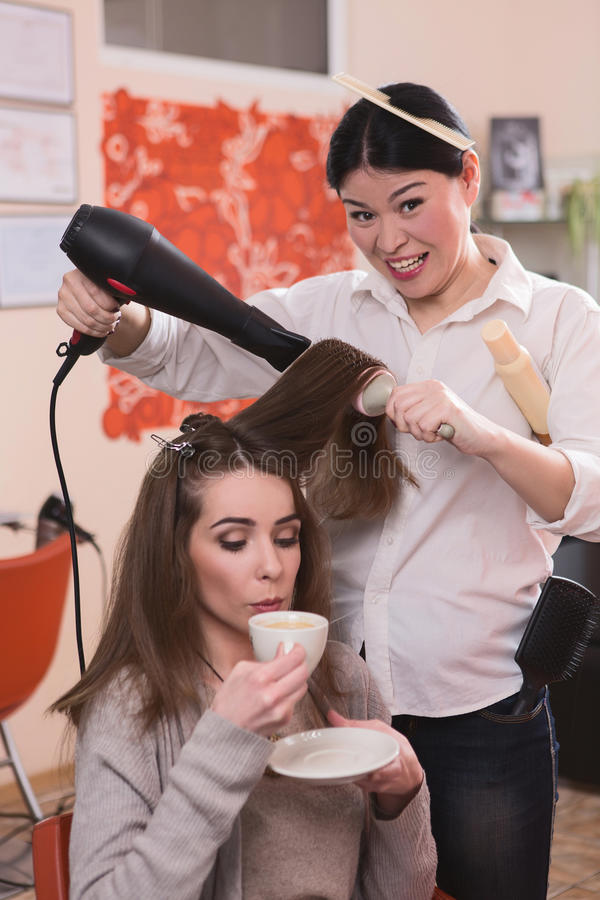 Beautiful lady in hairdressing saloon royalty free stock photography