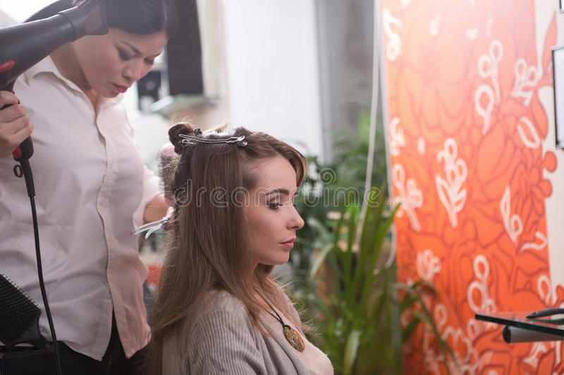 Beautiful lady in hairdressing saloon stock photo