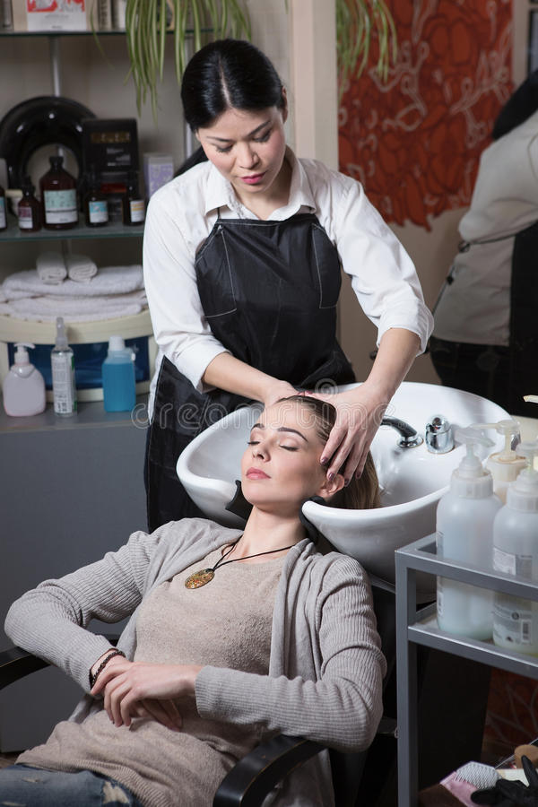 Beautiful lady in hairdressing saloon royalty free stock image