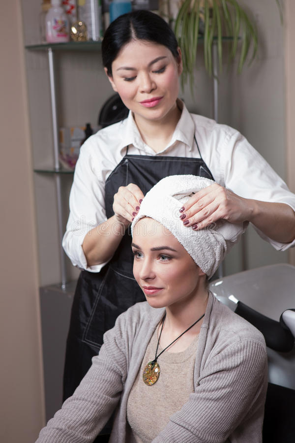 Beautiful lady in hairdressing saloon stock photography