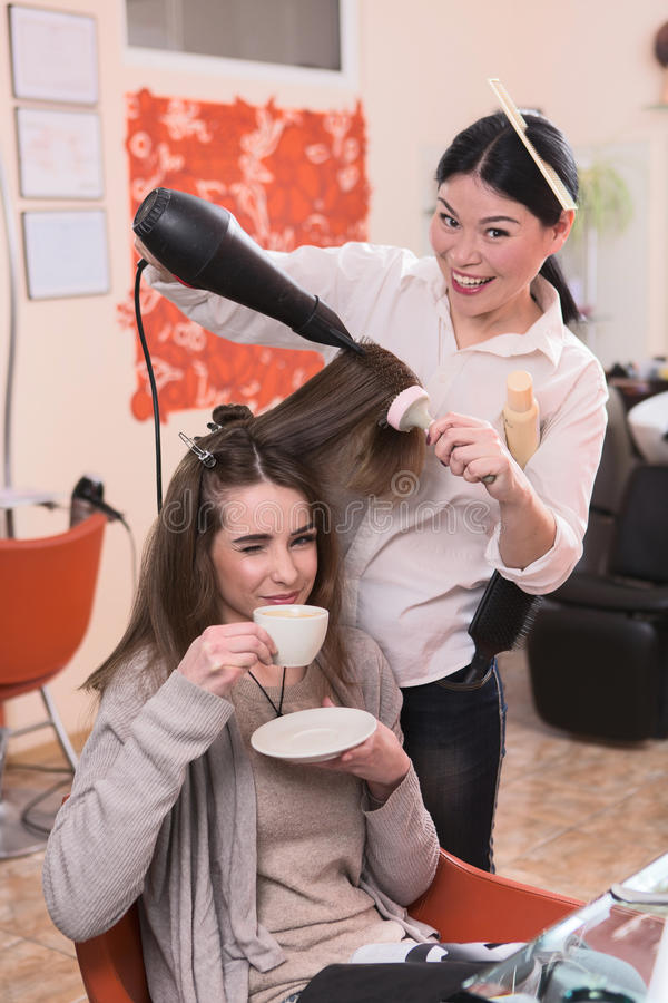 Beautiful lady in hairdressing saloon royalty free stock photos