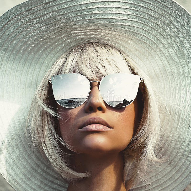 Beautiful lady in hat and sunglasses royalty free stock images