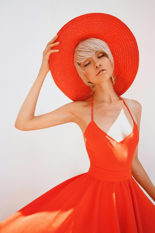 Free Beautiful Lady In Red Hat And Dress Stock Photos - 114978863