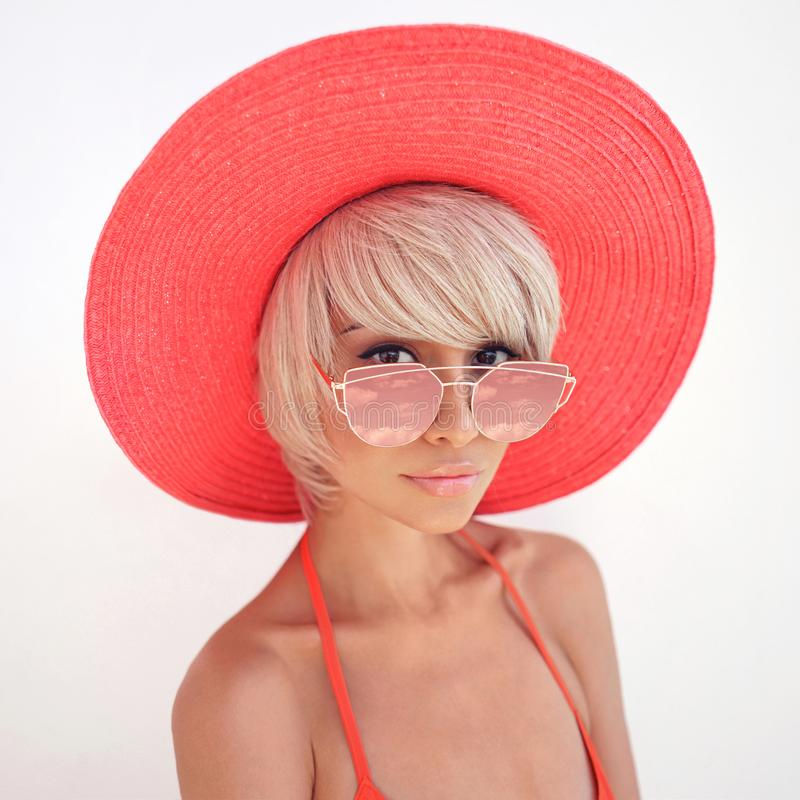 Free Beautiful Lady In Red Hat And Sunglasses Stock Photo - 114978860