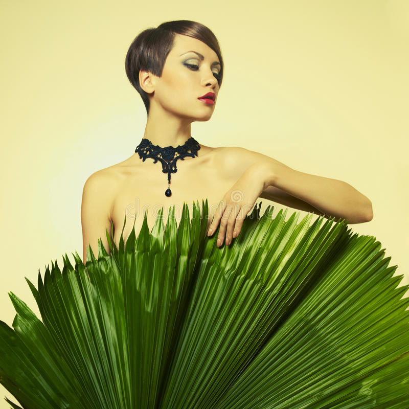 Beautiful lady with palm leaves