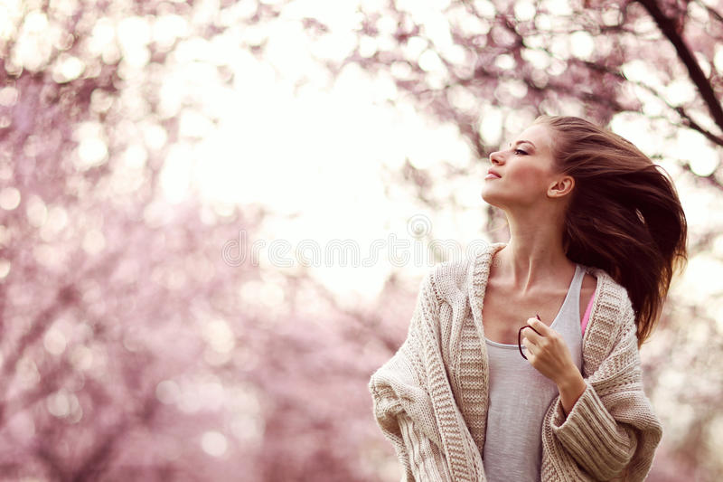 Beautiful Lady in the park in spring time. Lovely day stock images