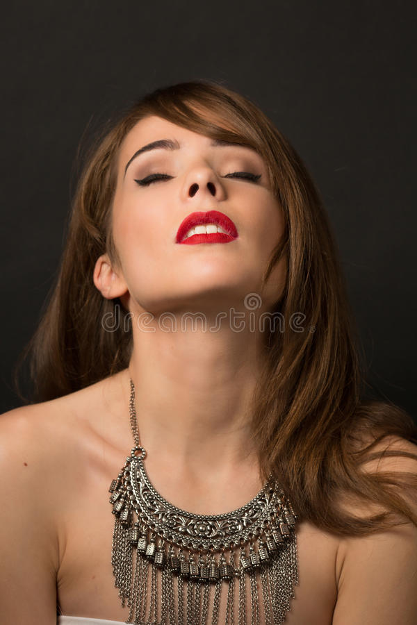 Beautiful lady posing with necklace in studio royalty free stock images