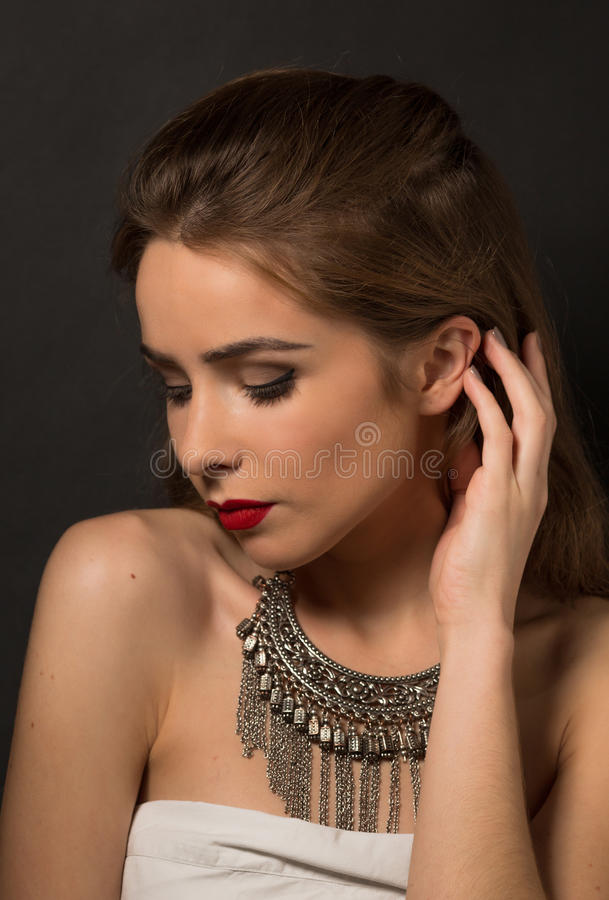 Beautiful lady posing with necklace in studio royalty free stock photos