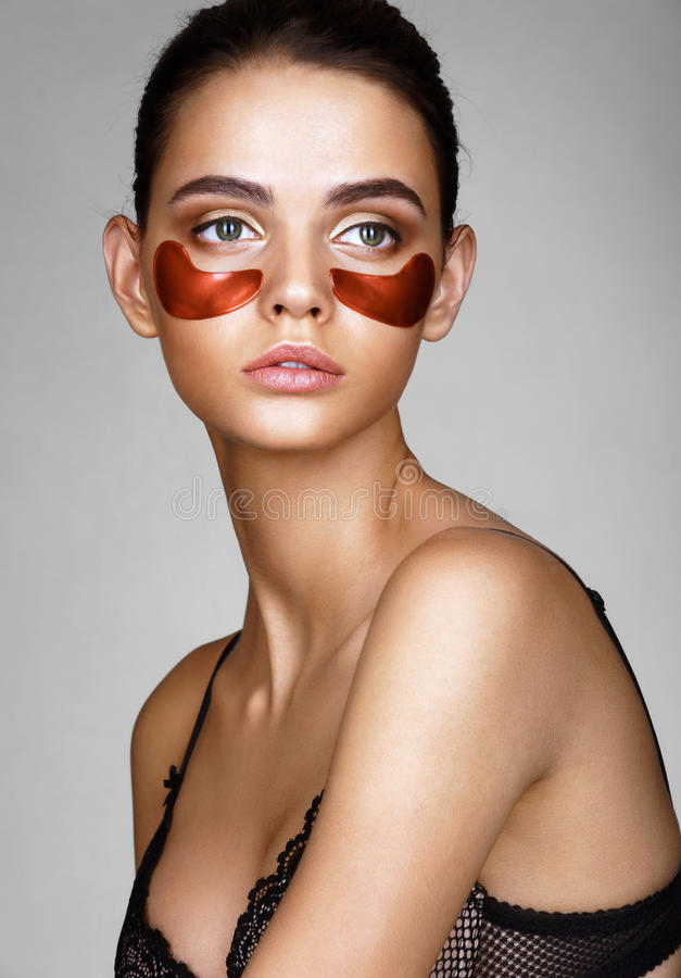 Beautiful lady with red eye patches. stock photography