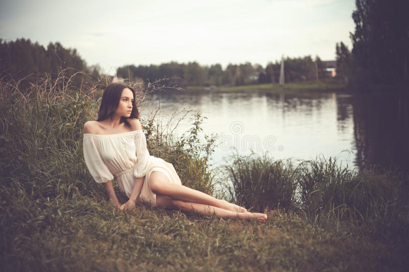 Beautiful lady at river stock photo