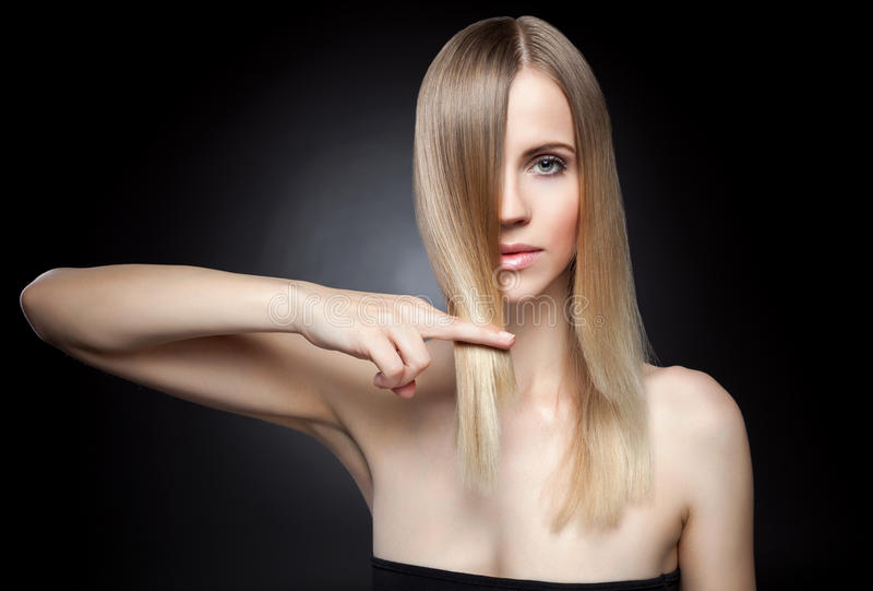 Beautiful lady with straight hair royalty free stock images