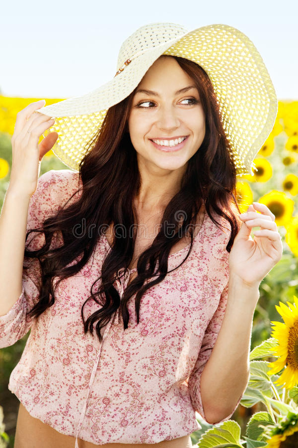 Beautiful lady in sunflower field