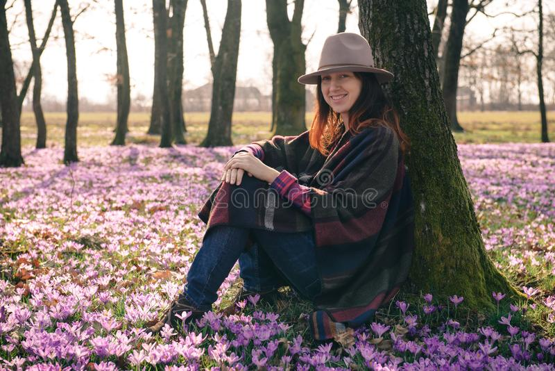 Spring.Crocuses.Forest.Fresh air. Inspiration. Female traveler. Beautiful lady traveler in a forest lit with sunshine, crocus aroma, fresh air that has got a royalty free stock image