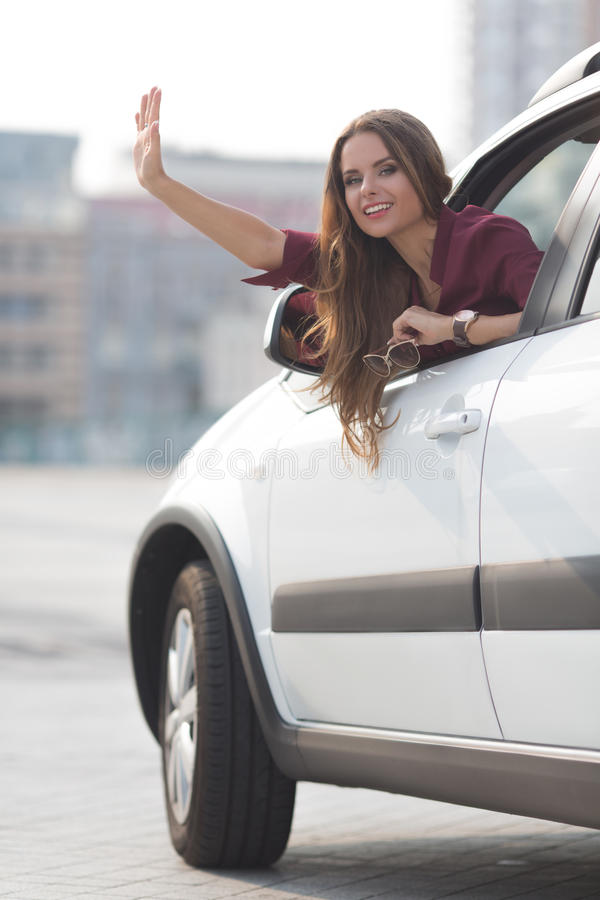 Beautiful Lady Waving From Her Car Stock Image - Image Of -3025