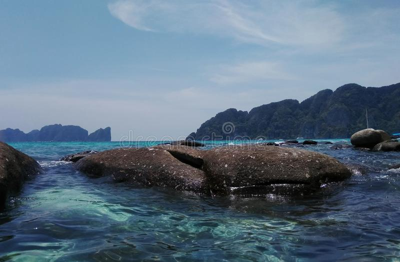 Beautiful lagoon, green sea clear water and stones royalty free stock photos