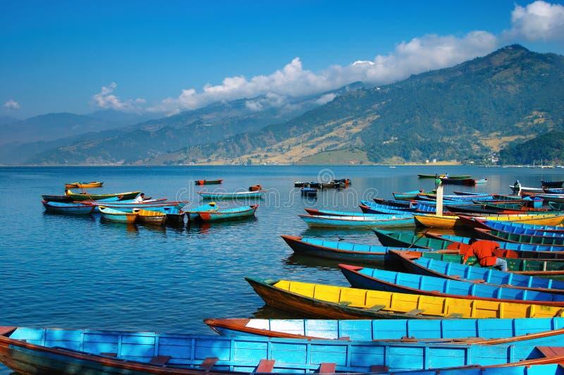 Beautiful lake. Colorful boats on Fewa lake, Pokhara, Nepal royalty free stock images