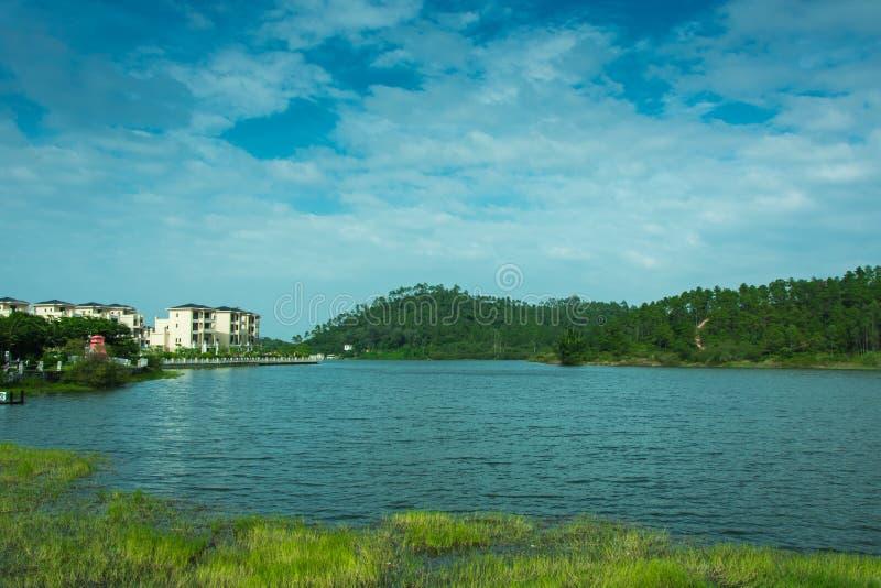 Beautiful lake and blue sky. Beautiful lake,green hills and blue sky in Yangxi,China stock photos