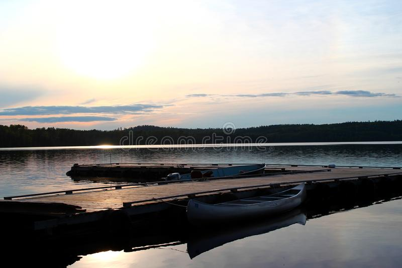 Beautiful sunset: Wonderful and moody lake in Canada / Ontario. Beautiful and lake in Canada / Ontario - Wonderful place for vacation and holiday royalty free stock photo