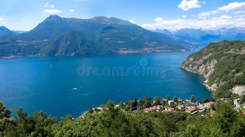The beautiful Lake Como is surrounded by the high mountains in Italy. stock photography