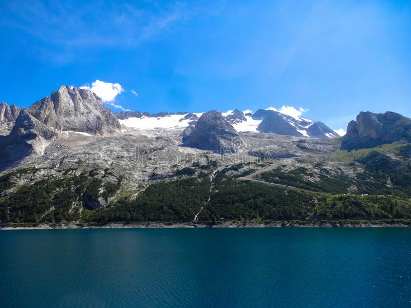 The beautiful Lake Como is surrounded by the high mountains in Italy. royalty free stock photo