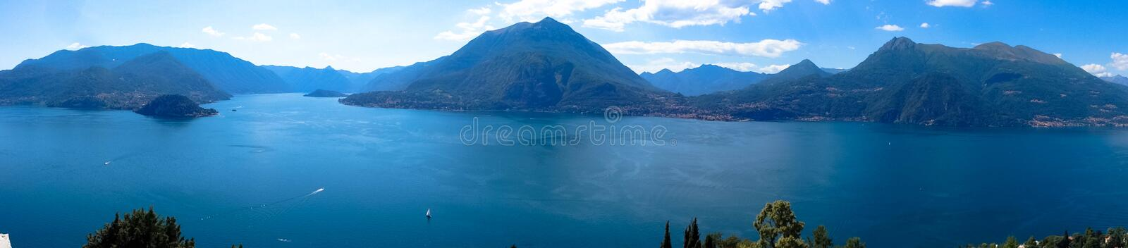 The beautiful Lake Como is surrounded by the high mountains in Italy. royalty free stock image