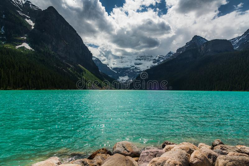 Beautiful Lake Louise in Banff, Alberta. Lake Louise shows off her extraordinary blue hue to all that visit her stock image