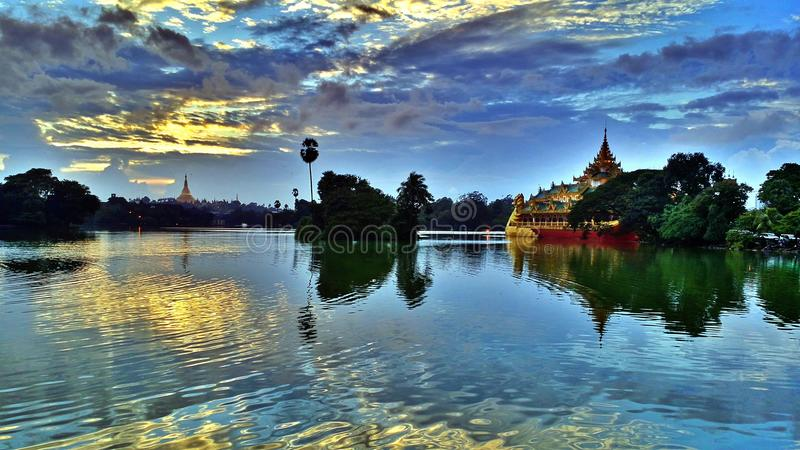 Beautiful lake in Myanmar. Kandawgyi lake that we can see Shwedagon pagoda and Karaweik restaurant in Yangon, Myanmar stock photo