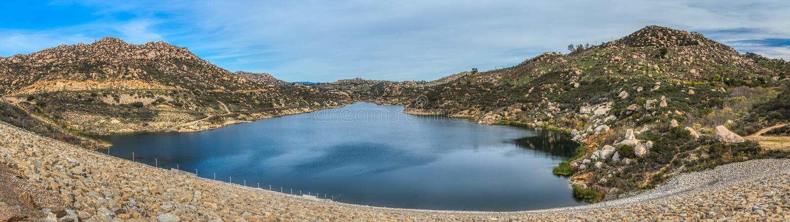 Beautiful Lake Ramona Panorama. Beautiful Lake Ramona surrounded by mountains in an elevated location seen from the Green Valley Truck Trail, Blue Sky Ecological royalty free stock photo