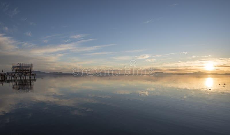 Beautiful lake sunset. Sunset on the Lake Trasimeno, Umbria, Italy stock photography