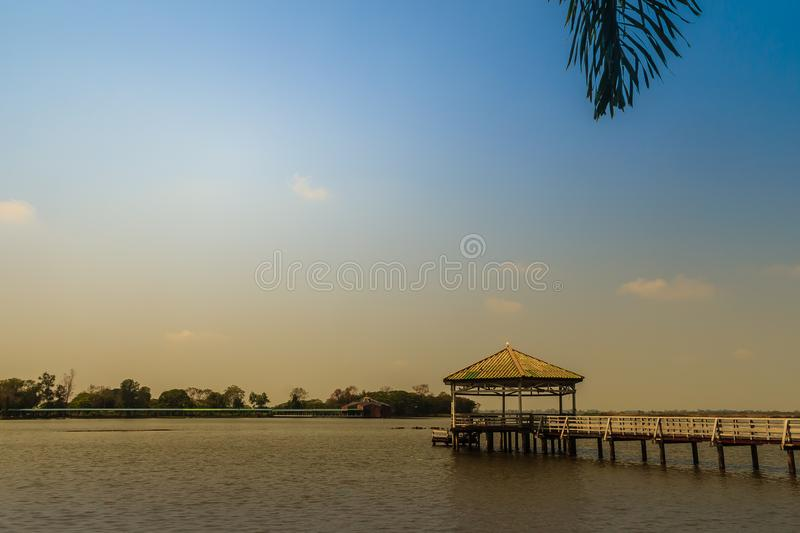 Beautiful lake view with the wooden pavilion at Bueng See Fai, the public park with lake at Muang district, Pichit province, Thail royalty free stock photo