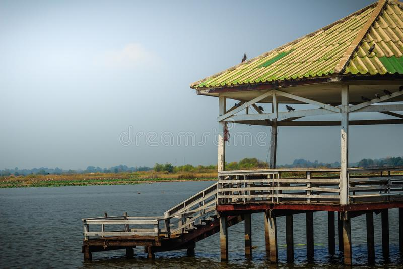 Beautiful lake view with the wooden pavilion at Bueng See Fai, the public park with lake at Muang district, Pichit province, Thail stock photography