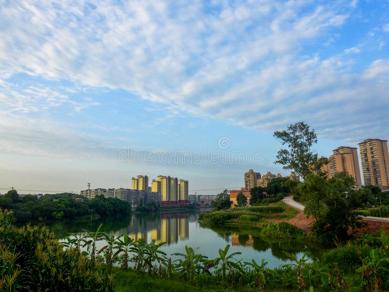 Lakeside High-rise Residential Area. Beautiful lake water and blue sky, lakeside villas, housing villages,villages and towns, China, Asia stock photos