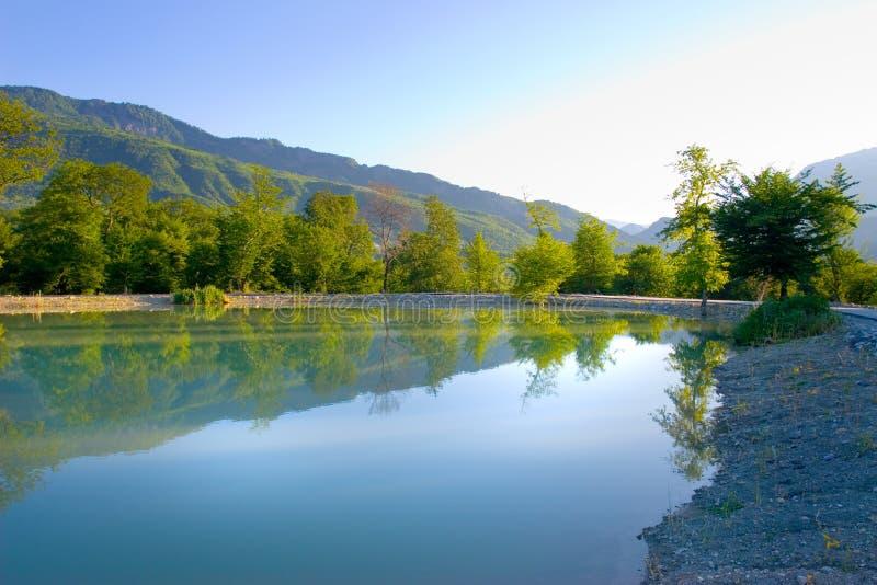 Beautiful lake in wood stock photo