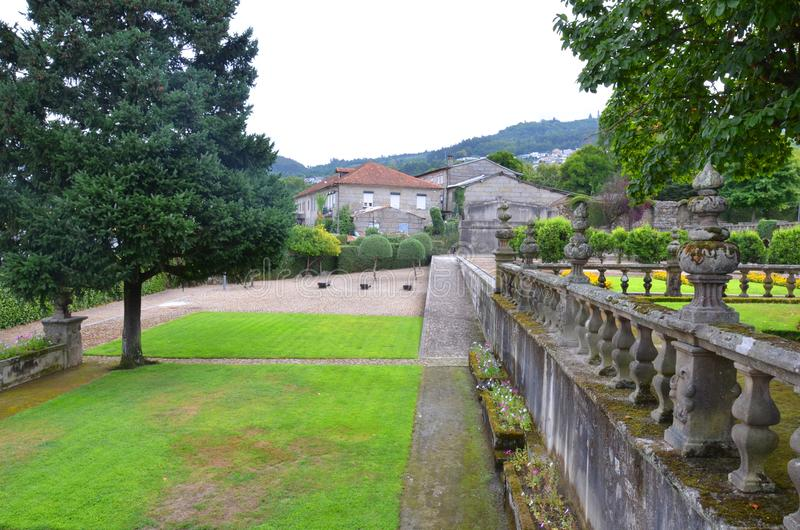 Vila Flor, Guimaraes, Portugal. Beautiful 3-landing garden decorated with a Baroque fountain near Vila Flor. Vila Flor Palace, built by Tadeu Luis Antonio Lopes royalty free stock photo