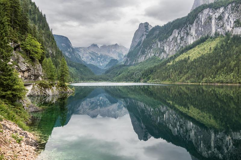 Beautiful landscape of alpine lake with crystal clear green water and mountains in background, Gosausee, Austria. Romantic place. royalty free stock photography